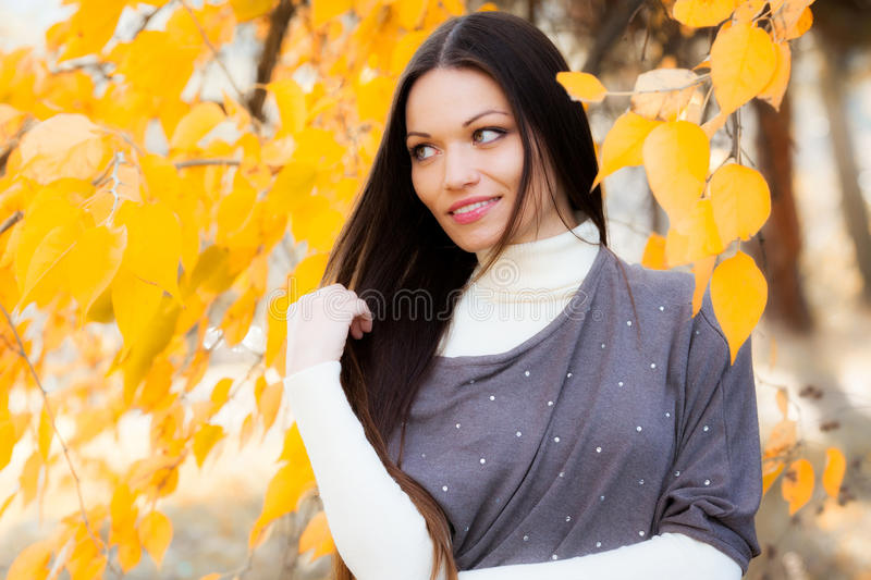 Girl In Autumn Garden Royalty Free Stock Photography