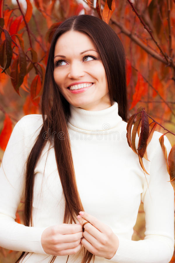Girl In Autumn Garden Royalty Free Stock Images