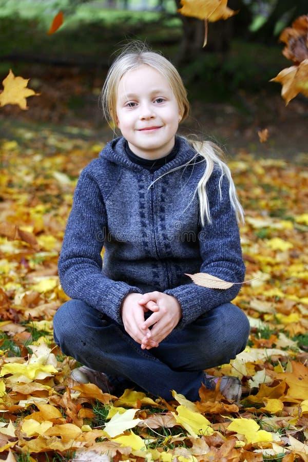 Girl in Autumn park stock photo