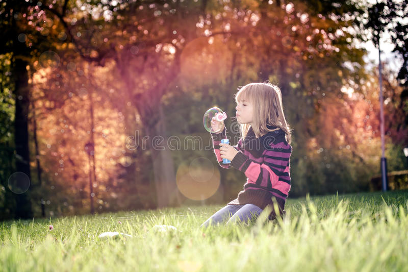 Girl in the autumn park stock image