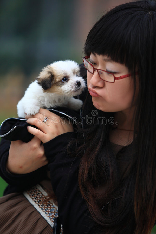 Girl with baby dog royalty free stock image