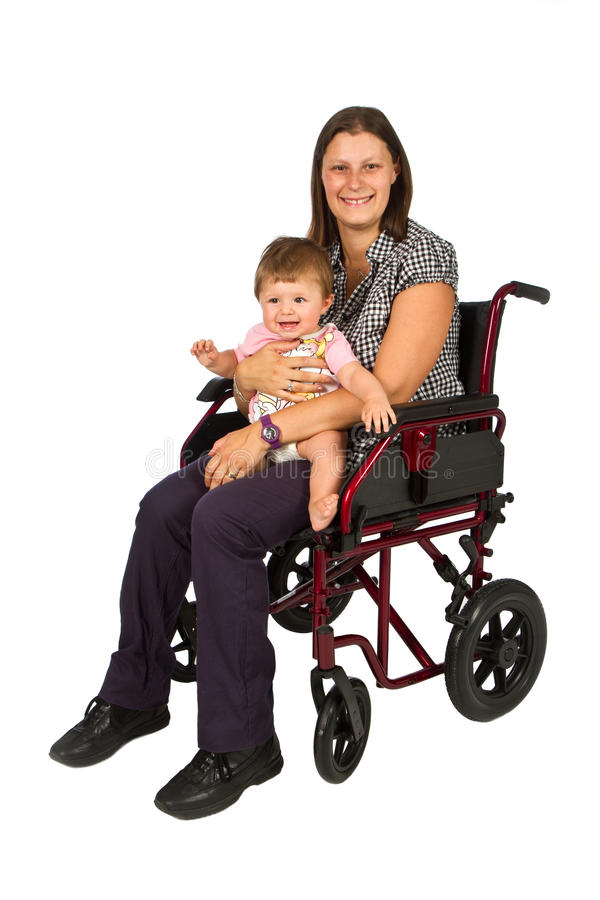 Girl with a baby in a wheelchair stock image