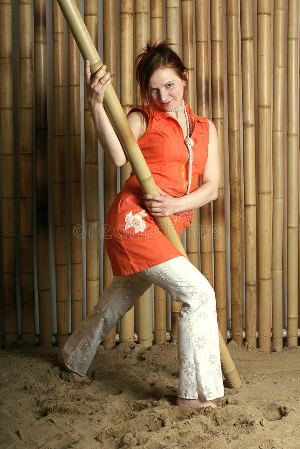 Girl on background of the bamboo 3 stock photo