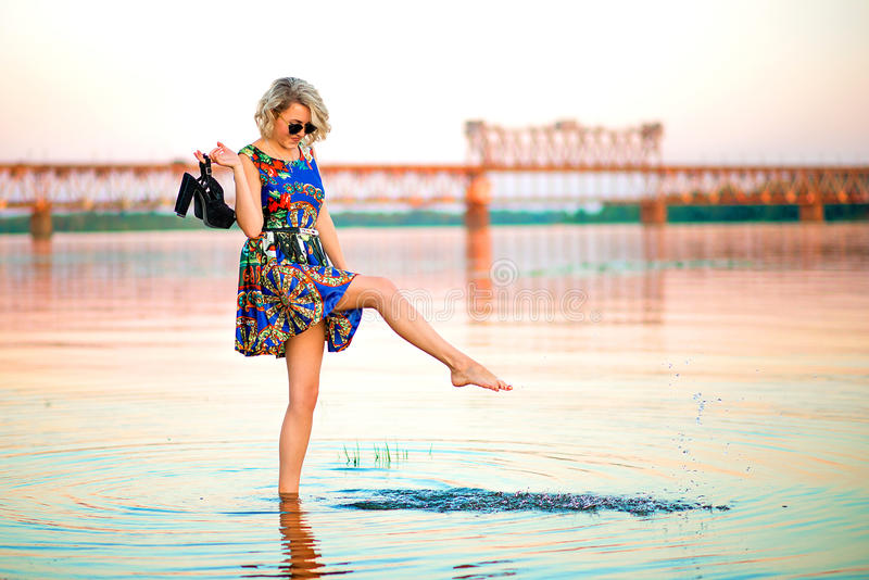Girl on the background of the bridge stock photography