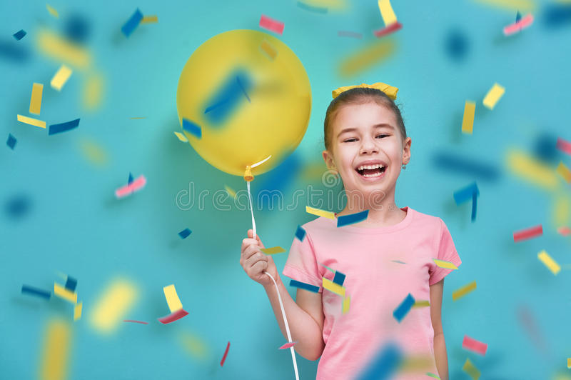 Girl on background of bright blue wall stock photos