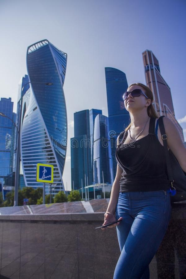 Girl on the background of the business center Moscow city stock photos