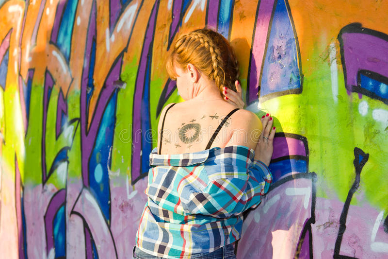 Girl on a background of graffiti royalty free stock images