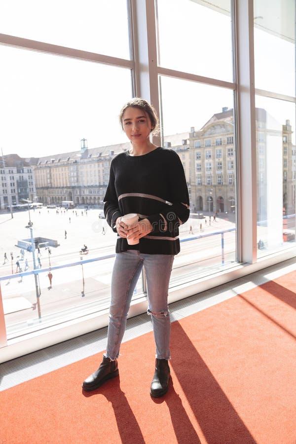 Girl on background of window overlooking Altmarkt royalty free stock image