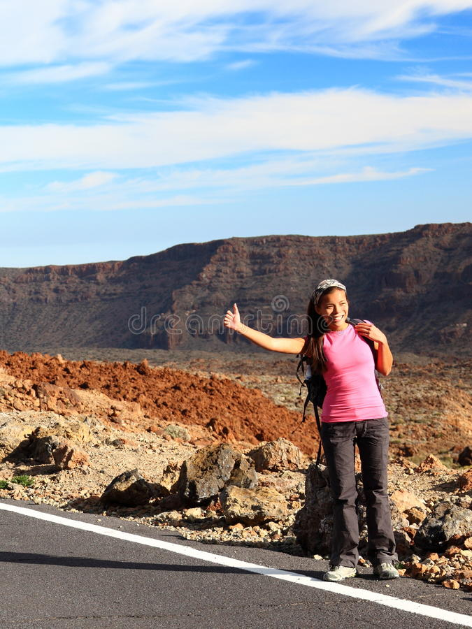 Girl Backpacking / Hitchhiking on Teide, Tenerife. Mixed chinese / caucasian woman model stock photos