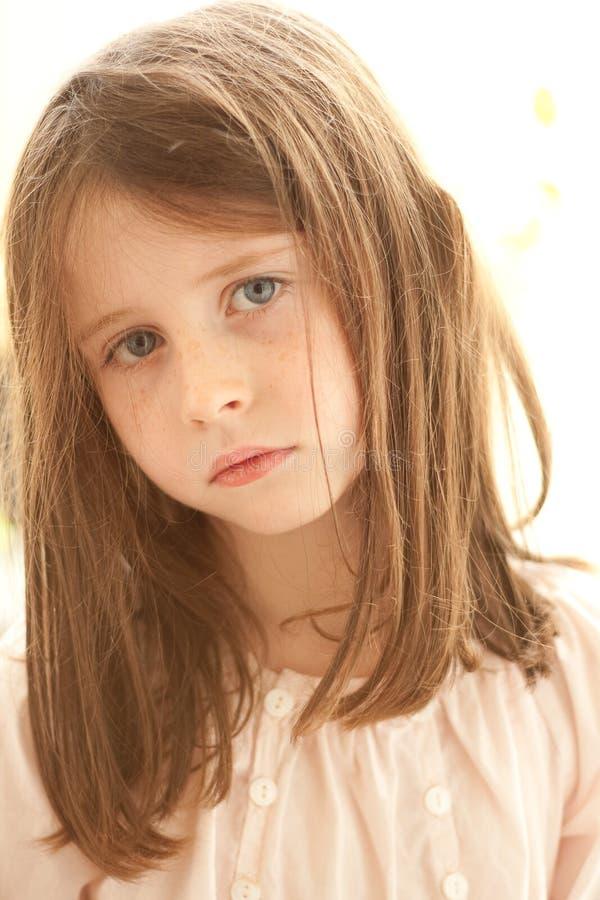 Girl in a bad mood stock photos
