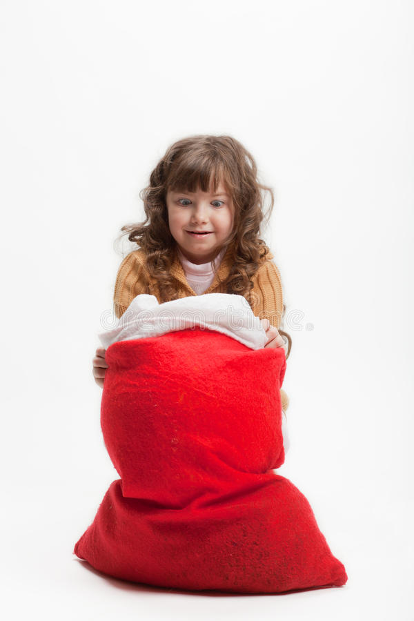 Girl And A Bag Of Gifts Royalty Free Stock Images