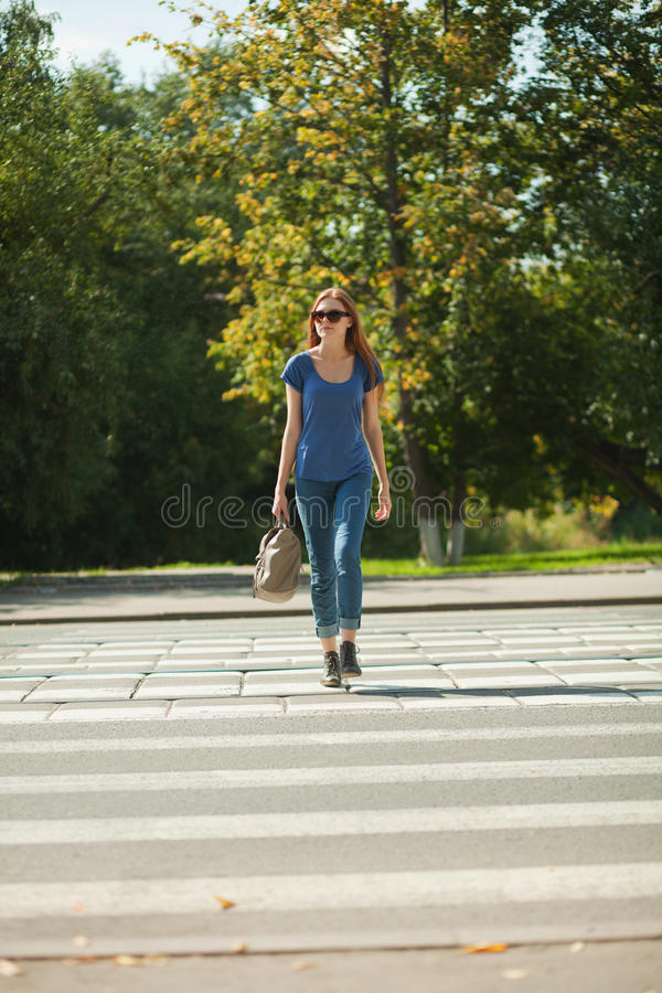 Girl With A Bag Goes The Way Of Pedestrian Zebra Royalty Free Stock Images