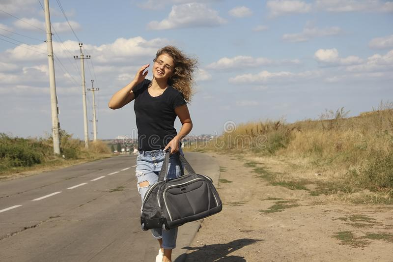 Girl with a bag the road summer stock photos