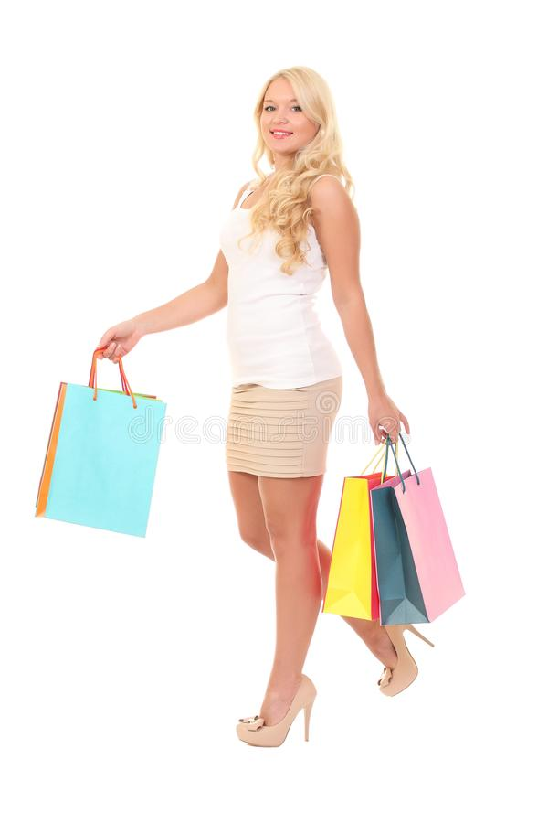 girl with bag walking on white background stock photo