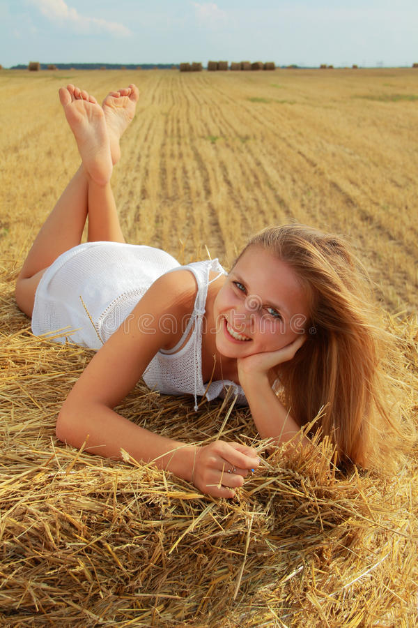 Download Girl on a bale stock image. Image of dress, girl, beauty - 21418735