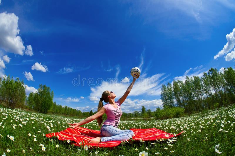 Girl with a ball of white flowers stock images