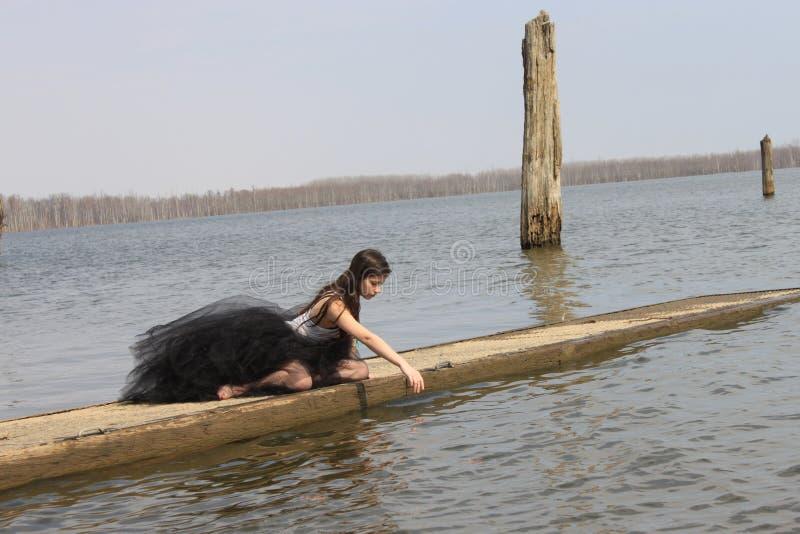 Girl in Ballerina Skirt on Dock stock photography