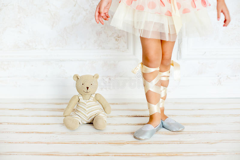 The girl the ballerina with a teddy bear stock photos