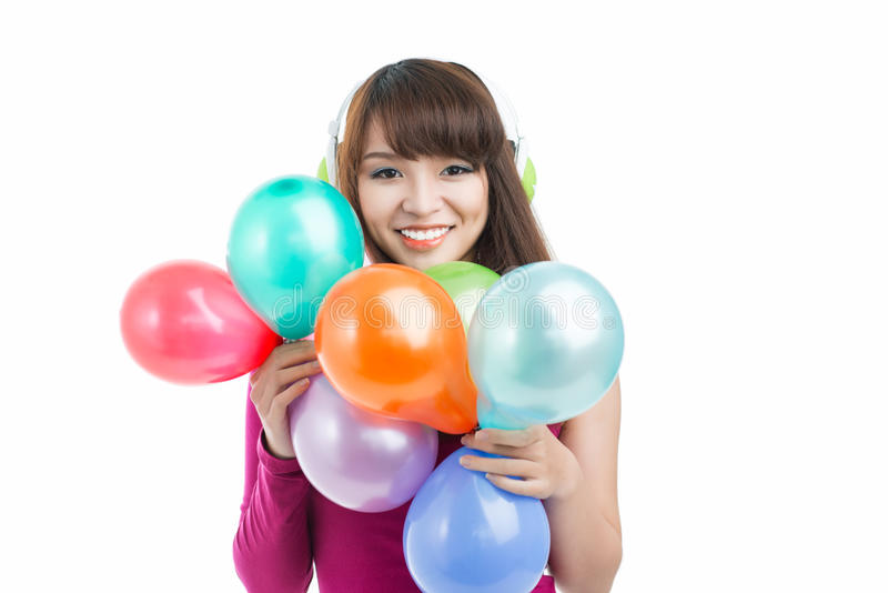 Girl with balloons. Cheerful girl with a lot of balloons smiling at camera stock photography
