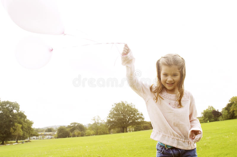 Girl with balloons in park. stock images