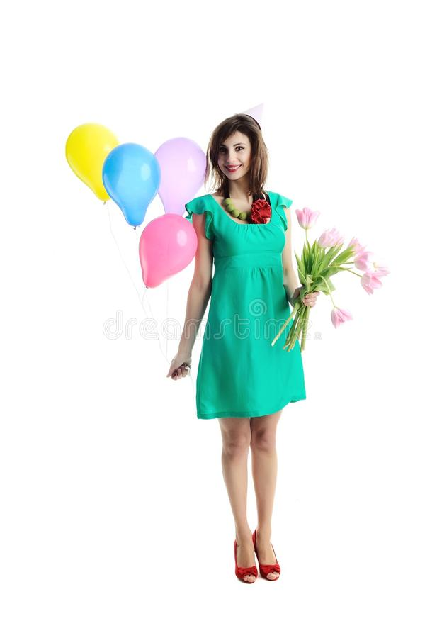 Girl with balloons and tulips stock photography
