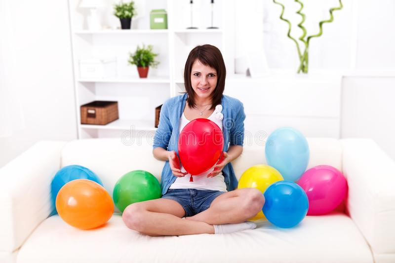 Girl and baloons royalty free stock photography