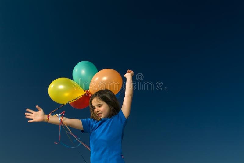 Girl and baloons royalty free stock image