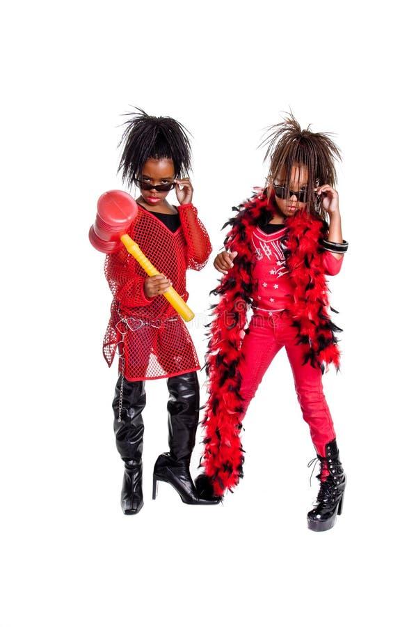 Girl Band. Multi ethnic group of young girls playing Girl band dress up stock image