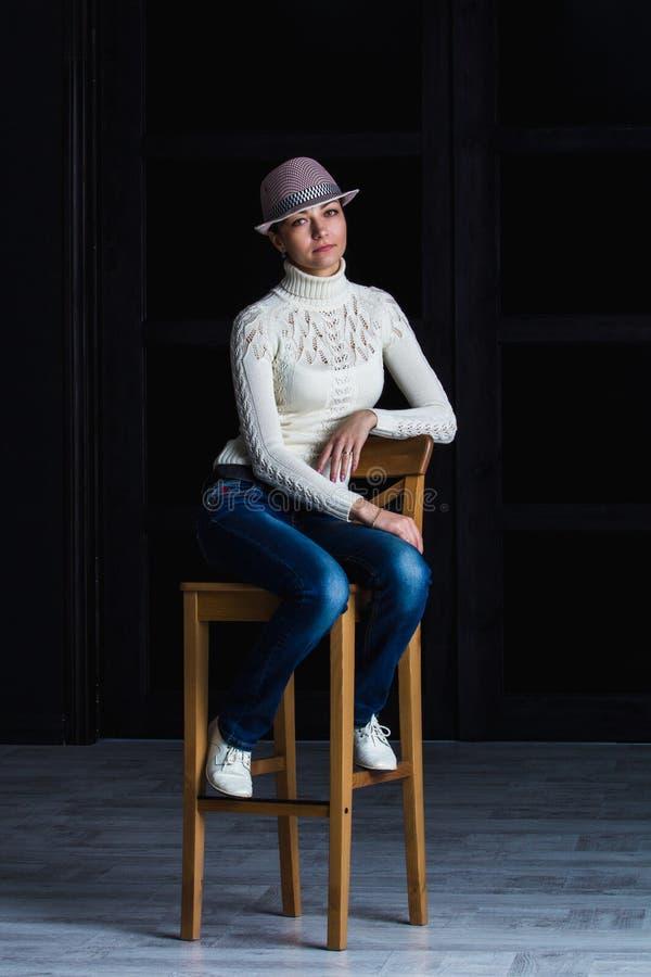 Girl on a bar stool stock photos