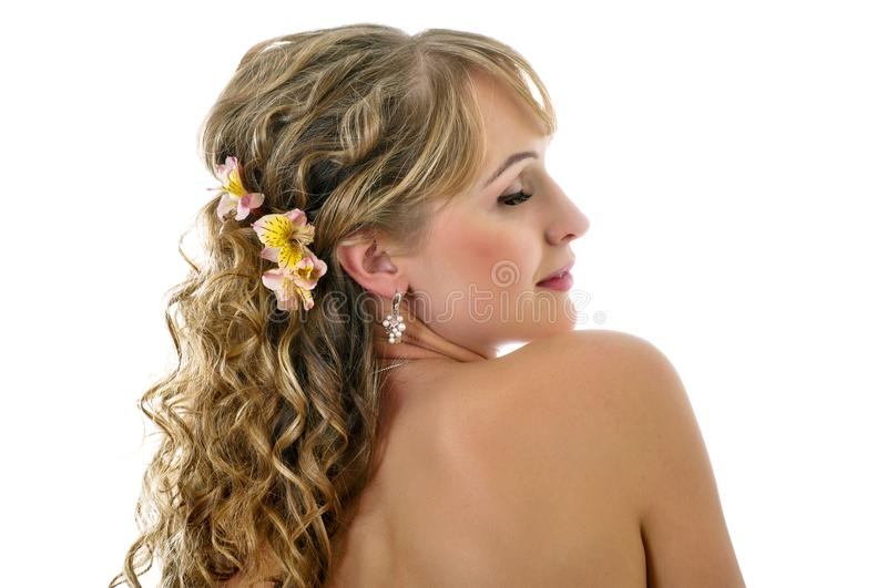 Girl with bare shoulders and closed eyes on a white royalty free stock image