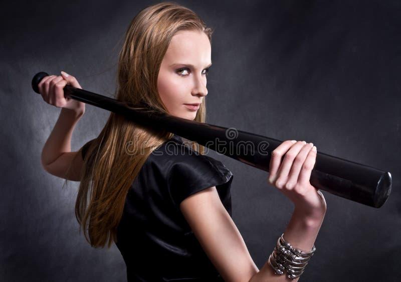 Girl with the baseball bat royalty free stock photos