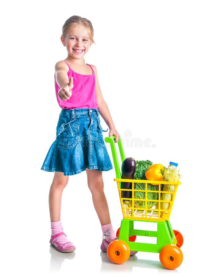 Girl with a basket of products from the. Cute little girl with a basket of products from the supermarket isolated on white royalty free stock photos