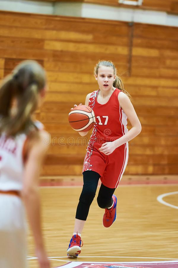 Free Girl Basketball Player With Ball In Game Stock Photos - 108693883