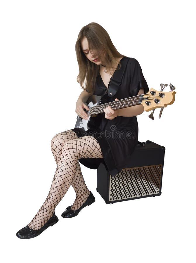 Girl with bass guitar stock photo