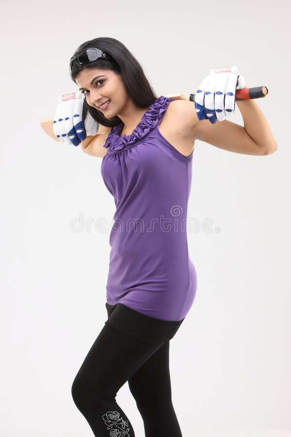 Girl with bat on her shoulders royalty free stock images