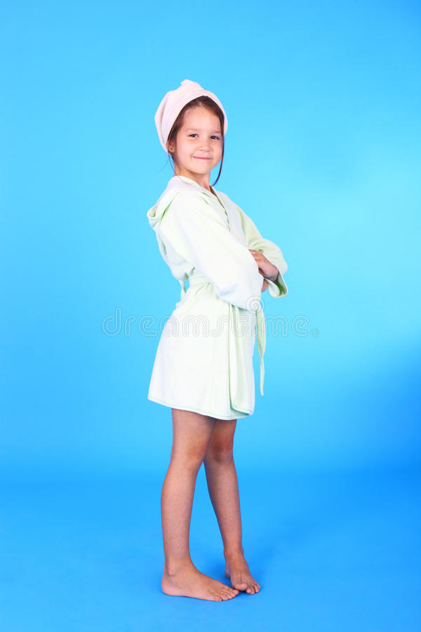 Girl in the bath robe stock photography