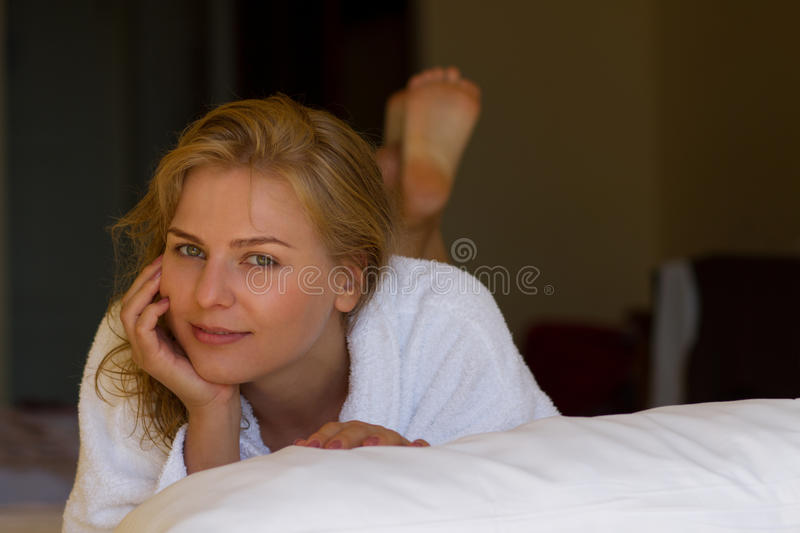 Girl in bathrobe after bath in hotel stock images