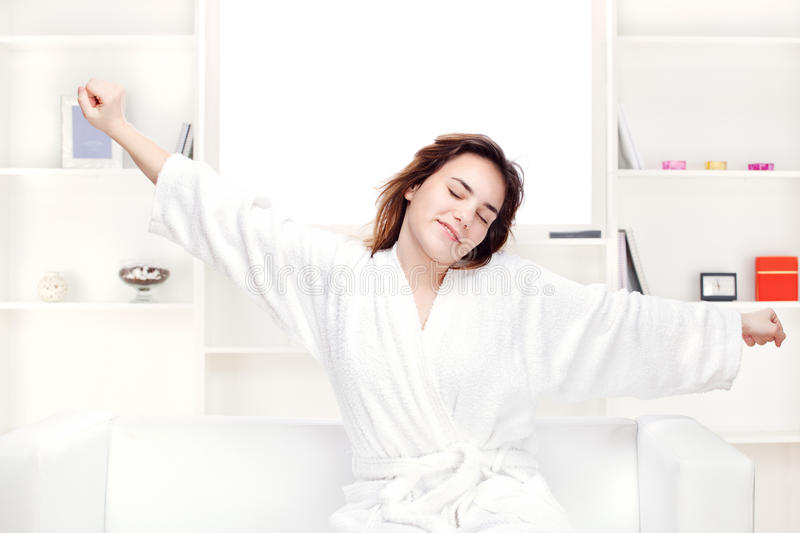 Download Girl In Bathrobe At Home Stretching Arms Royalty Free Stock Image - Image: 23314296