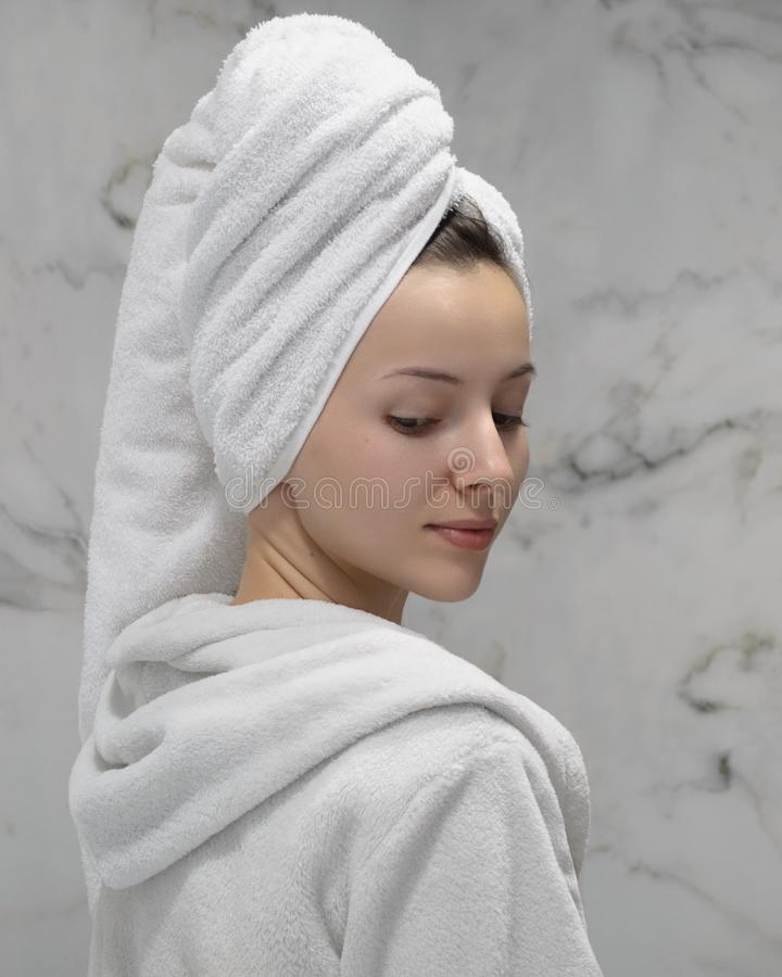 A girl in the bathrobe royalty free stock image
