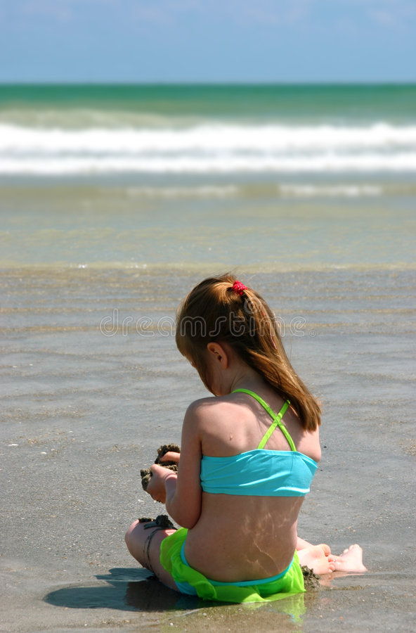 Girl on beach royalty free stock photography