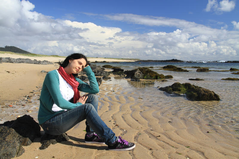 Girl on the beach. Of Canto Marinho wondering - Nominated for one of the wonders of Portugal in the category of Wild Beach stock image