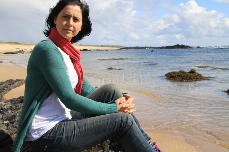 Girl on the beach. Of Canto Marinho wondering - Nominated for one of the wonders of Portugal in the category of Wild Beach stock photo