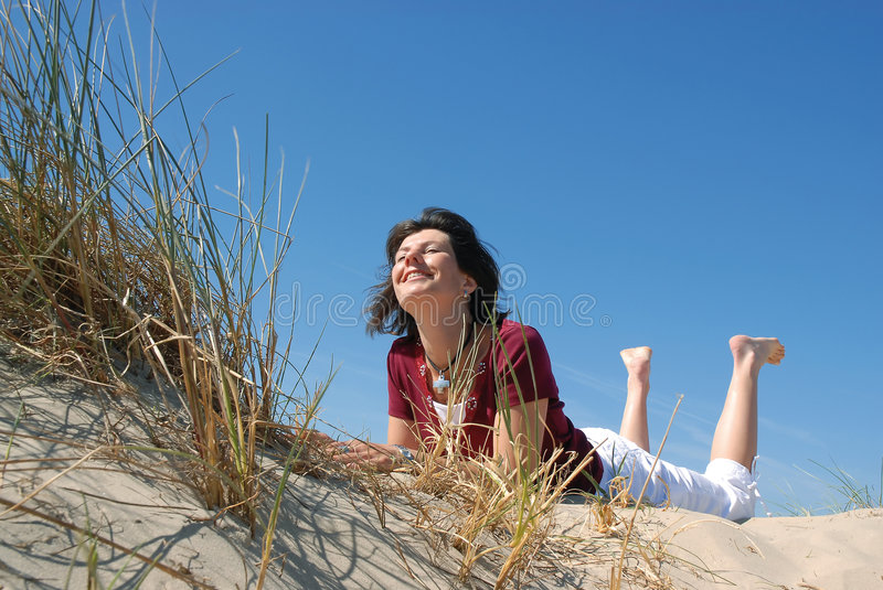 Girl on the beach stock image