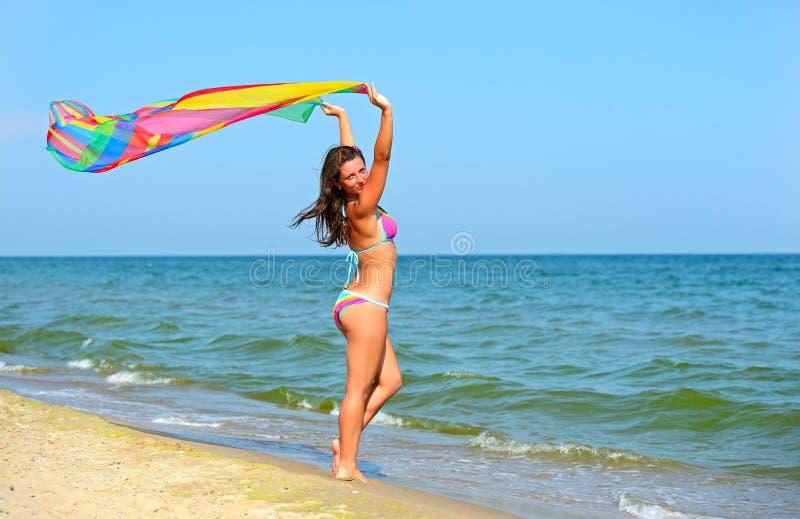 Girl on a beach. Beautiful Girl Jumping on The Beach royalty free stock photos