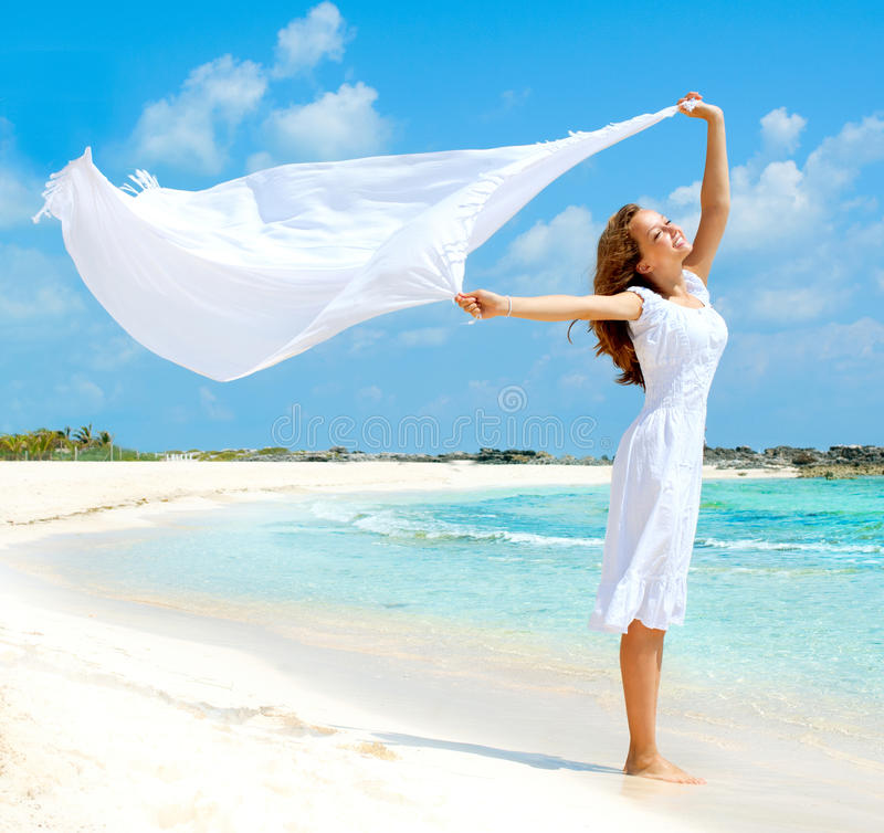 Girl on The Beach. Beautiful Girl With White Scarf on The Beach