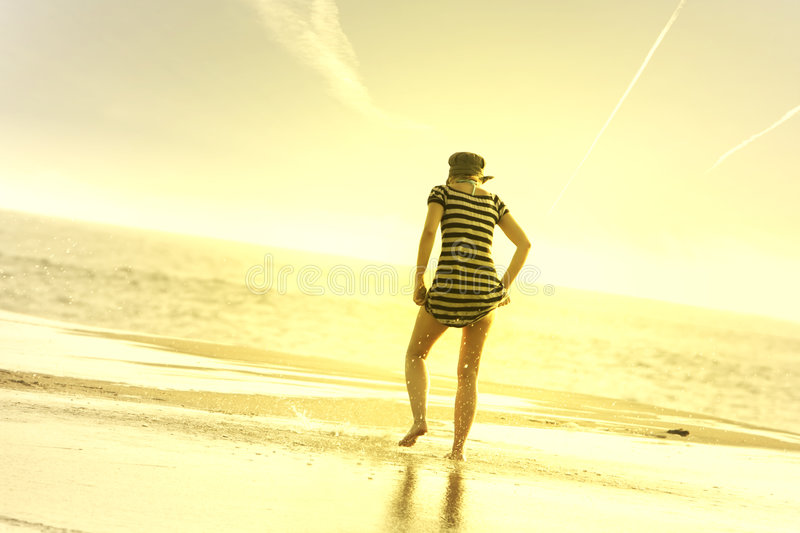 Girl in the beach stock images