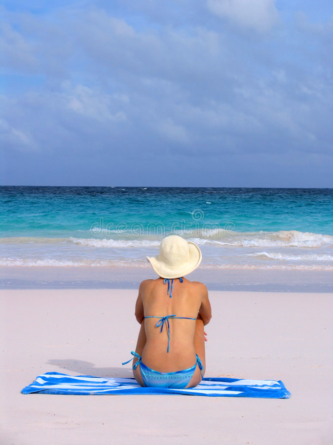 Girl at beach in blue bikini a royalty free stock images