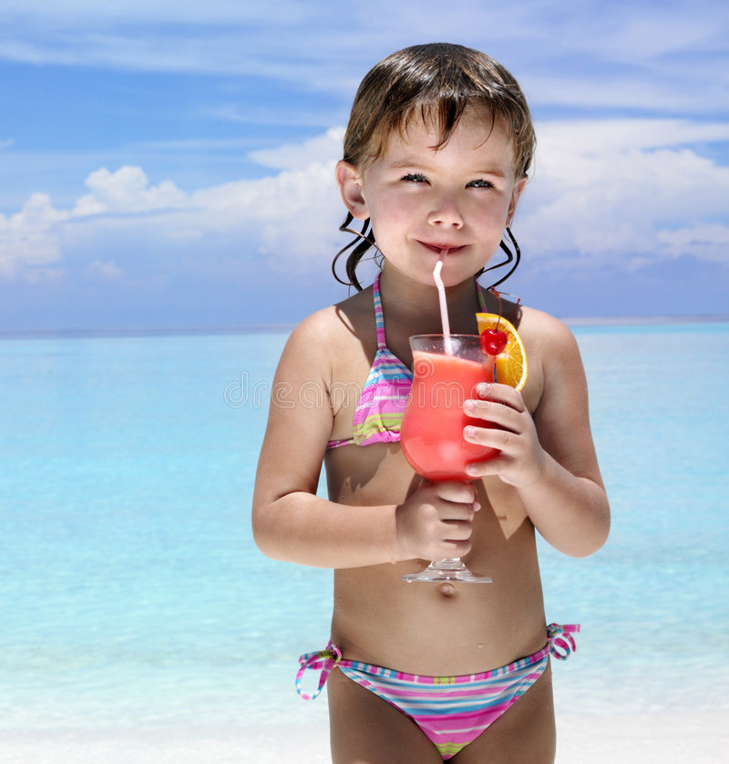 Girl on the beach with cocktail royalty free stock photo
