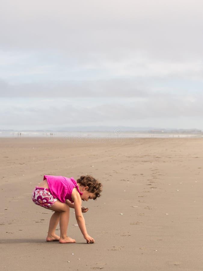 Girl beach combing stock photos