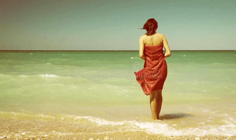 Girl on the beach. Conceptual scene royalty free stock image